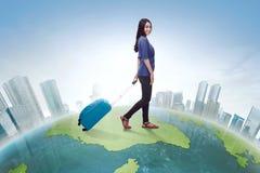 Traveler asian woman walking carrying suitcase Stock Photo