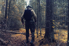 Traveler in autumn forest Stock Image