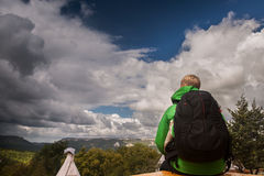 Traveler with backpack enjoyed with autumn mountain camp view Stock Images