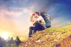 Traveler with backpack hiking over sky background Stock Images
