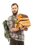 Traveler with backpack and logs Stock Image