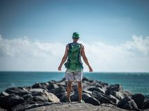 Traveler with backpack observing the seascape. Concept of travel and freedom.  stock image