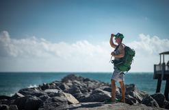 Traveler with backpack observing the seascape. Concept of travel and freedom.  royalty free stock photography