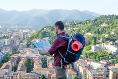 Traveler backpacker in front of a city destination Royalty Free Stock Photography