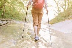 Traveler walking along the river in summer. stock photo
