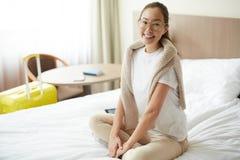 Traveler on bed Stock Image
