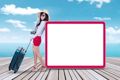 Traveler with billboard at pier Stock Photo