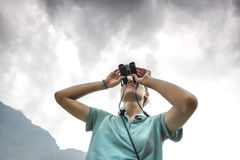 Traveler with binoculars in Sapa Valley Royalty Free Stock Image