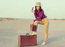 Traveler with binoculars and suitcase Royalty Free Stock Photography