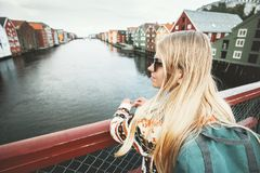 Traveler blonde woman sightseeing Trondheim city. On bridge in Norway Lifestyle vacations outdoor scandinavian landmarks architecture Stock Image