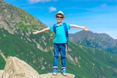 Traveler boy enjoys the beauty of the mountains and freedom stan stock images