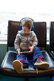 Traveler Boy Watching Movie on Phone Royalty Free Stock Photos