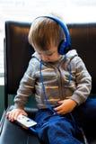 Traveler Boy Watching Movie on Phone Royalty Free Stock Photo