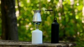 Brewing coffee in a green forest. stock footage