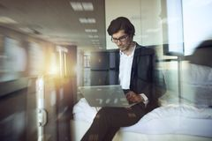 Traveler businessman with his laptop ready to fly. Double exposure stock image