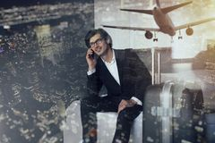 Traveler businessman at the phone ready to fly. Double exposure. Traveler businessman at home speaks at phone. Double exposure stock photos