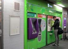 Traveler buying subway tickets Stock Photos