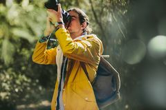 Traveler capturing the beauty of nature in a camera stock photos