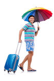 Traveler with cases and umbrella isolated on white Stock Image