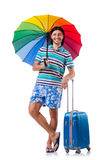 Traveler with cases and umbrella isolated on white Royalty Free Stock Photo