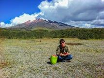 Traveler Caucasian woman eating a watermelon, Cotopaxi volcano stock photography