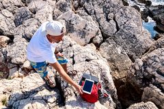 Traveler charges the tablet using a solar battery royalty free stock image