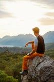 Traveler on the cliff Stock Photo
