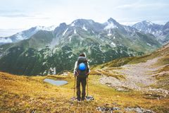 Traveler climbing alone in mountains travel adventure lifestyle royalty free stock photography