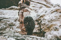 Traveler climbing at rocky mountains Travel Lifestyle wanderlust adventure concept summer. Vacations view under feet boots perspective Stock Image