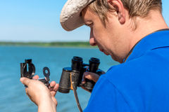 Traveler with compass and binoculars Royalty Free Stock Photo
