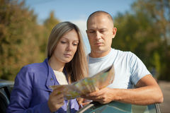 Traveler couple looking at the map. On the country road Stock Photo