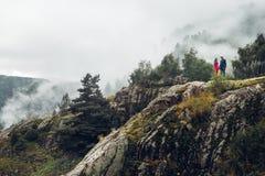 Traveler couple in love enjoying view of mountains Royalty Free Stock Image