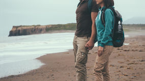 Traveler couple in love walking on coastline Royalty Free Stock Photo
