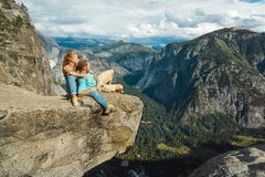 Traveler couple man and woman in Yosemite National Park, scenic view at Valley and Mountains from Upper Yosemite Falls, USA royalty free stock image