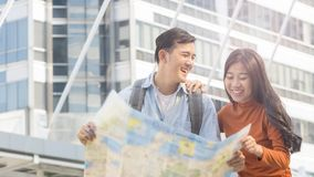Traveler couple people use generic local map and talk at urban c Stock Image