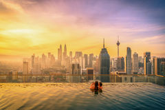 Traveler couple woman in swimming pool on the roof top of hotel Royalty Free Stock Images