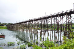 Traveler crossing bamboo bridge or Mon Bridge in Sangklaburi. Kanchanaburi, Thaila Royalty Free Stock Image