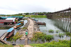 Traveler crossing bamboo bridge or Mon Bridge in Sangklaburi. Kanchanaburi, Thaila Royalty Free Stock Photos
