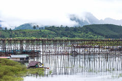 Traveler crossing bamboo bridge or Mon Bridge in Sangklaburi. Kanchanaburi, Thailand. Attractions traditional way of life Stock Photos
