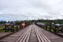 Traveler crossing bamboo bridge or Mon Bridge in Sangklaburi. Kanchanaburi, Thailand. Stock Image