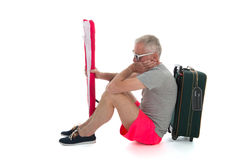 Traveler with delay. Man as traveler with suitcase having delay Royalty Free Stock Photography