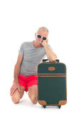 Traveler with delay. Traveler with suitcase having delay isolated over white background Stock Photos