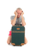 Traveler with delay. Traveler with suitcase having delay isolated over white background Stock Photography