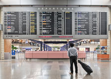 Traveler and departure board stock photos