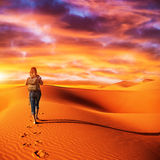 Traveler in the desert Royalty Free Stock Images