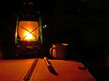 Traveler diary. Diary and vintage lantern in the night stock photography
