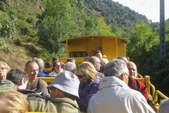 The traveler in the discovered wagon. Of the yellow Pyrenees train royalty free stock photos