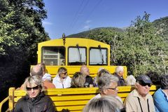The traveler in the discovered wagon. Of the yellow Pyrenees train royalty free stock image