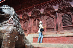 Traveler in Durbar square at Kathmandu Nepal. Durbar Square is the generic name used to describe plazas and areas opposite the old royal palaces in Nepal. It Stock Photos