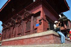 Traveler in Durbar square at Kathmandu Nepal. Durbar Square is the generic name used to describe plazas and areas opposite the old royal palaces in Nepal. It Royalty Free Stock Photography